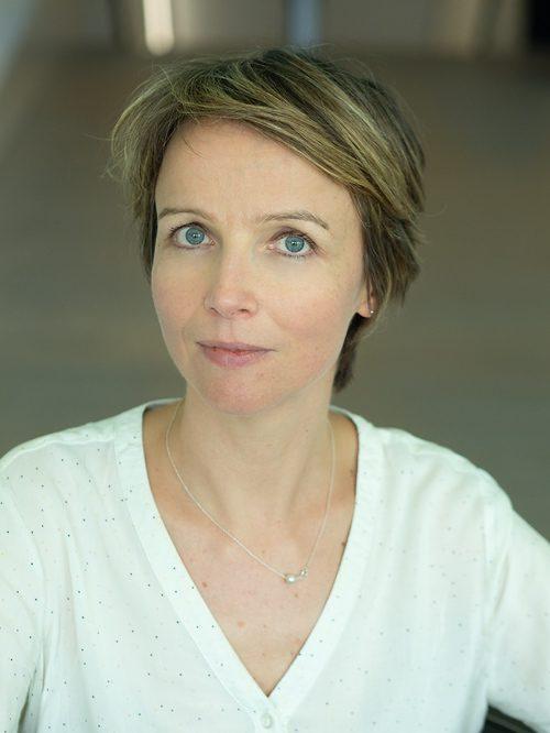 Mme. Natacha Roos